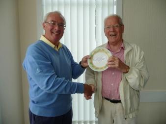 "Ian Middlemist (Turnhouse - 2014 SEDSGL Secretary) hands over the ""20th Anniversary"" china plate to Easton Kynoch (Glencorse - founder club of the SEDSGL)"